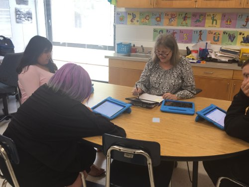 Aline Reavis, (center) Yadkin County Schools Teacher works on HillRAP with students (left to right), Aixa Cristobel, Talin Shumate and Chris White