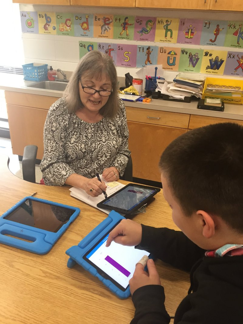 Teacher Aline Reavis works on HillRAP with student Chris White