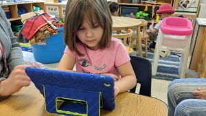 Central Davie PreSchool student Serenity Rose works with Cognitive ToyBox