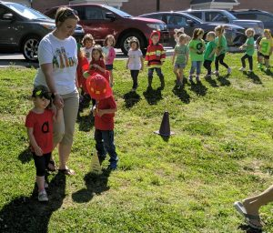 Allison Gupton, preschool teacher at First United Methodist Church in Mocksville leads students in Letterland parade