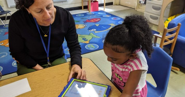 Josey Redinger, NC Pre-K teacher at Central Davie preschool watches as pre-k student Zakoiya Summers works with Cognitive ToyBox