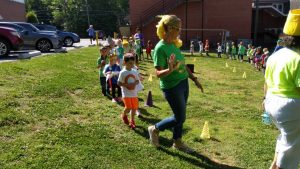 Deitre Junker, preschool teacher at First United Methodist Church in Mocksville leads students in Letterland Parade
