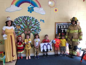 Preschool teachers Susan Domanski (left) and Amanda Harris (right) with their class of 2-year-olds at FUMC preschool in Mocksville wearing Letterland character costumes