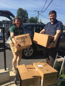 Susan Jameson, media assistant for WSFCS, and Caleb Masters, assistant bookstore manager, load boxes of books to be delivered to the school system's Instructional Resource Center for processing and delivery to a school.