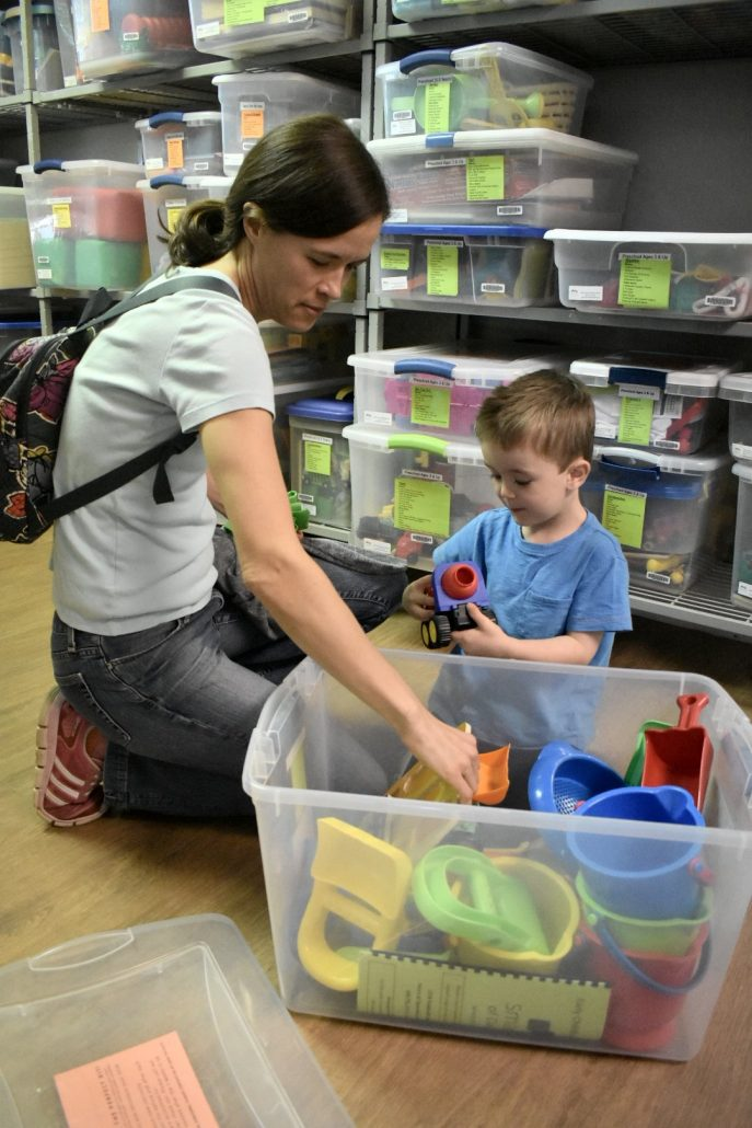 Emily MacCaull and her son Tommy explore free Smart Start Toy Kits