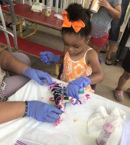 Daijah Emwanta participates in tie-dying Group Connections activity