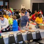 Dozens of volunteers help sort and pack books. at Book Harvest 2020