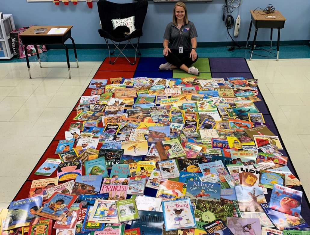 Rebecca Boyles with some of the 300 new books she was able to purchase with her Mebane Foundation first-year teacher grant.